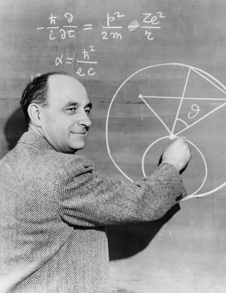 Italian-born physicist Enrico Fermi (1901-1954) at the chalkboard