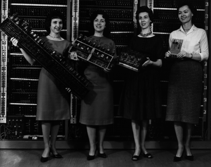 US Army Photo (163-12-62) Patsy Simmers, Gail Taylor, Milly Beck, and Norma Stec with parts from ENIAC, EDVAC, ORDVAC, and BRLESC-I