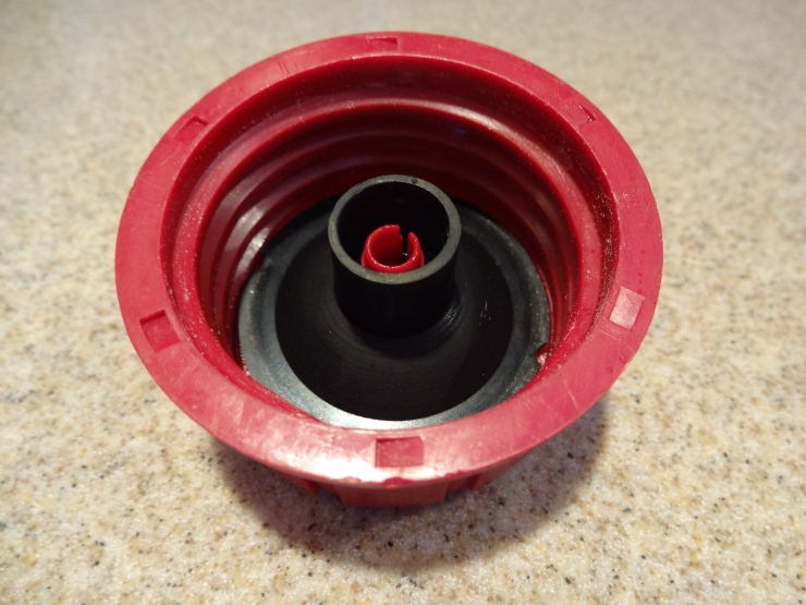 Snowblower gas cap with insert